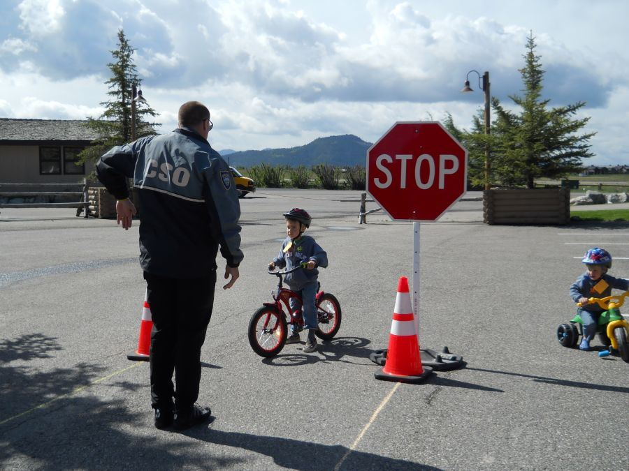 Police Officer with kids riding their bikes