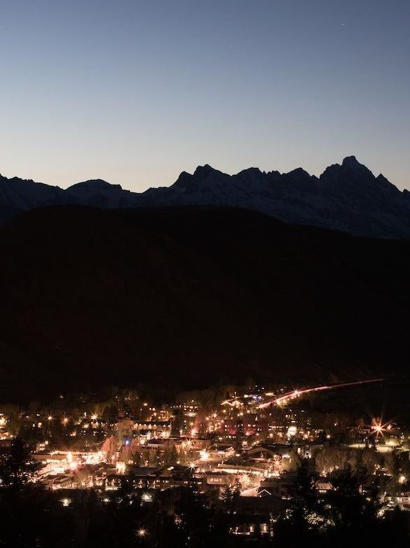 Town at night Outline of Tetons